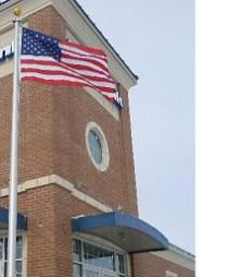 Commercial flagpole in front of small business